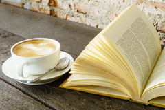 Reading vintage old book with coffee Royalty Free Stock Images
