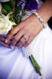Reading Vows. Bride holding bouquet during wedding vows Royalty Free Stock Image
