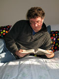 Reading on a Warm Bed royalty free stock photography