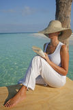 Reading by the Water Royalty Free Stock Photos