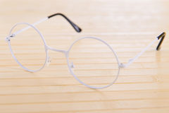 Reading white glasses Royalty Free Stock Image