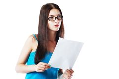 Reading a white letter. Brunette young woman shocked realizes that something amazing or bad happened reading a white letter or document royalty free stock photo