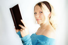 Reading woman. A young, blond woman is reading a book Stock Photo