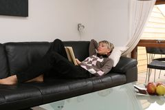 Reading woman #3. Reading woman on the sofa Royalty Free Stock Images