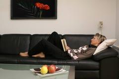 Reading woman #4. Reading woman on the sofa Stock Photos