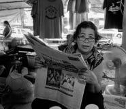 Reading woman, Mae Phim market. Thailand Stock Photo