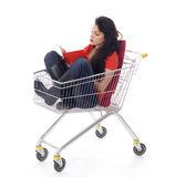 Reading woman in shopping cart Stock Images