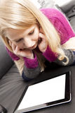 Reading woman with tablet PC Royalty Free Stock Photo