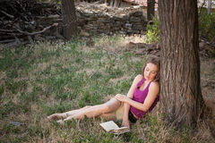 Reading in the woods Royalty Free Stock Image