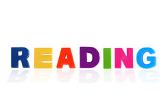 Reading written In Multicolored Plastic Kids Letters Stock Image