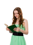 Reading. Young woman reading a book side view Stock Photo