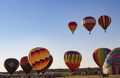 Readington, New Jersey/USA - 7/30/2017: [Festival of Ballooning; Hot Air Balloons Start Rising Into the Sky] royalty free stock images