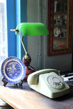 Readng lamp and telephone Stock Photo