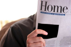 Reads the newspaper Stock Photography