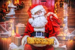 Reads a wish list. Santa Claus is preparing for Christmas, he reads a list with children`s desires. House of Santa Claus. Christmas decoration royalty free stock photos