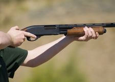 Ready. Shotgun raised to firing position with finger safely off the trigger Royalty Free Stock Photography