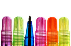 Ready. Colorful ballpens with one in different direction, ready to be used; white background. Focus on the blue pen stock photos