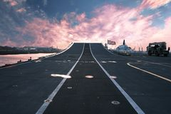 Ready for Action. On top of HMS Ark Royal aircraft carrier and flagship of the British Royal Navy at sunset. Wide angle lens used Royalty Free Stock Image