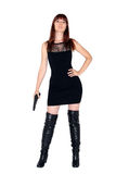 Ready for action. Woman holding a gun ready to protect Stock Photos