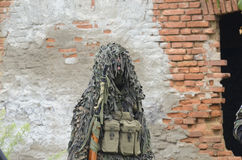 Ready for the action. A military man camouflaged before the battle Stock Photos