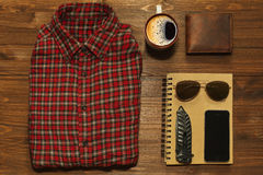 Ready for adventure. Something for outdoors adventure in retro style - chekered shirt, scetchbook, cell phone, jackknife, wallet and sunglasses stock images