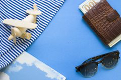 Travel concept blue background with beach essentials. Ready for adventures. Blue one-color background with tourist essentials, top view. Space for a text or Royalty Free Stock Photo