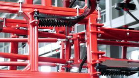 Ready agricultural machinery in red color. New equipment for agriculture