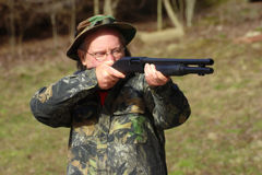 Ready aim fire!. A white male dressed in camouflage ready to fire a 12 gauge shotgun Stock Images