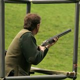 Ready ,aim, fire. Clay pigeon shooter waits for his targey Stock Photo
