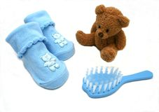 Ready for Baby. Blue baby booties, brush and bear Stock Photography