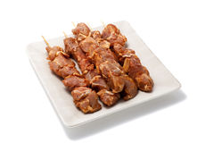 Ready for barbecue. Skewers with meat on a plate. Isolated on white Stock Photography