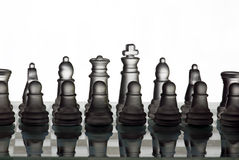 Ready for the battle. Glass chess pieces as a white army on a glass chessboard ready for the battle or the competition Royalty Free Stock Images