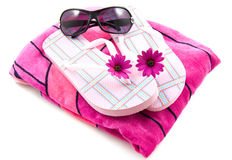 Ready for the beach. Pink towel with pink sandals and sunglasses isolated over white Royalty Free Stock Photo