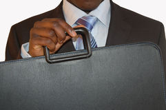 Ready for business. This is an image of a black man holding a brief case/portfolio Stock Photo