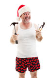 Ready For Christmas - Dad with Tools. Smiling father in a Santa hat, holding his tools. He's ready to assemble Christmas gifts stock photography