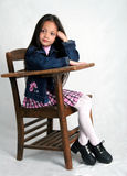 Ready for class. Young girl sitting in school desk Stock Images