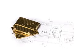 Ready CNC golden and silver metal detail on technical drawing sketch Royalty Free Stock Photos