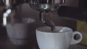 Coffee machine making preparing cups of coffees in coffee bar, close-up. stock footage