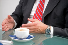 Ready for coffeebreak. Manager with red tie does a coffeebreak royalty free stock photos
