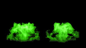 The green fire flares up and fades away, with alpha mask stock footage