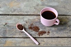 Ready for drink coffee. Coffee bean on spoon Stock Photography