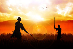 Ready For A Duel. Two Samurai in duel stance facing each other on dramatic landscape Royalty Free Stock Image