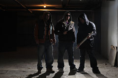 Ready for a fight. Gang members in a dark alley Royalty Free Stock Photos