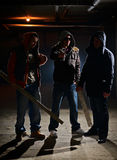 Ready for a fight. Gang members in a dark alley Royalty Free Stock Images