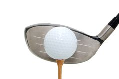 Ready for flight. Golf ball on tee and driver Stock Images