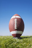 Ready for Football Kickoff. Football resting on a tee ready for kickoff Royalty Free Stock Images