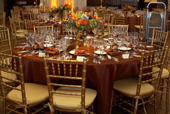 Ready for the formal dinner. The room is decorated and the tables are all set for a nice formal room. This is a fundraising event and the attendees paid a lot Stock Images