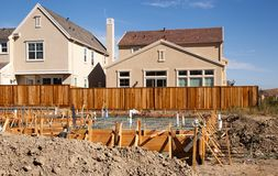 Housing starts, Silicon Valley builds. With new homes already constructed  new homes wait for their foundation to be poured in the close lots of Californias Royalty Free Stock Photo