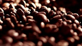 The ready fried coffee beans. A large amount of grains on a black background. Coffee close up. Slow mothion. Dark Coffee. On this video you can see coffee beans stock video footage