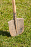 Ready for gardening. Spade in the ground ready for gardening, is time to plant flowers royalty free stock images